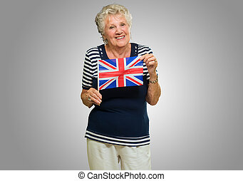 Woman Holding United Kingdom Flag - Portrait Of Senior Woman...