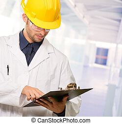 Technician Holding Writing Pad, Indoor