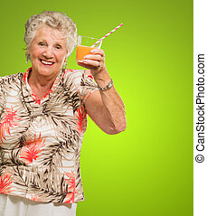 Senior Woman Holding Orange Juice Glass