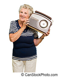 Senior Woman Listening Music - Portrait Of Senior Woman...