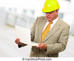 Portrait Of A Male Contractor Using Laptop