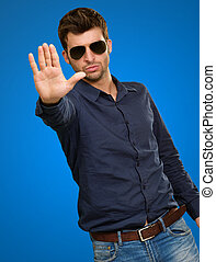Man Showing Hand Isolated On Blue Background