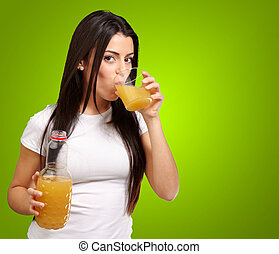 Women Drinking Orange Juice On Green Background