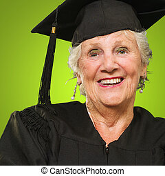 Mature Woman Wearing Graduation Hard - Happy Elderly Woman...