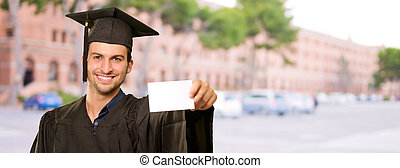 Graduate Man Holding Placard, Outdoor