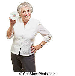 Senior woman holding cd isolated on white background