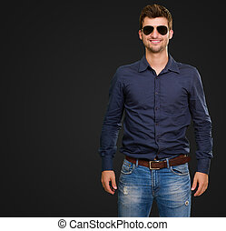 Smiling Young Man Isolated On Black Background