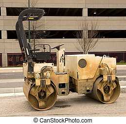 Old Paving Roller by Parking Deck - An old dirty paving...
