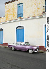 cuba - purple old american car parked on the street in...
