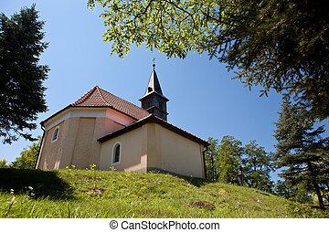 Church on a grassy hill