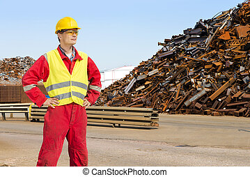 Recycling worker - Worker, with overalls, a hard hat and...