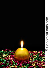 Round gold candle and beads. - Round gold candle and shiny...