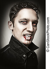 man with vampire style bangs, blood - Fashion portrait of a...