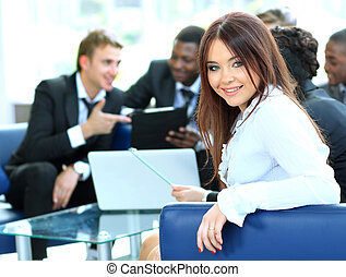 Closeup of a pretty young businesswoman smiling in a meeting...