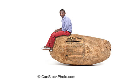 Boy Sitting on Potato - Handsome young black teenager...