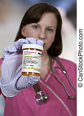 Doctor Holding Pills - Beautiful young female doctor on her...