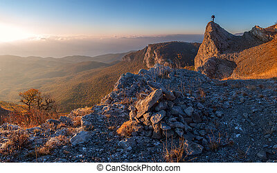 A man with camera - A man standing at mountain top with...