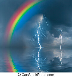 Colorful rainbow over water, thunderstorm with rain and...