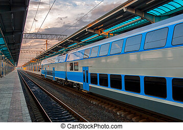 Train at railway station - High-speed commuter train at...