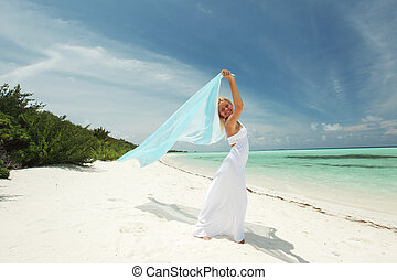 woman on the beach - woman with a white fabric in his hands...
