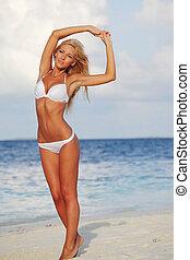 woman in bikini on sea background
