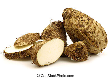 taro root (colocasia) - two cut fresh taro root (colocasia)...