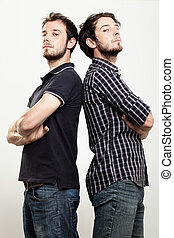 Confident Twins - Two Confident Twins with Arms Folded