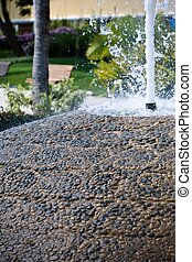 Waterfountain with a pebble stone design