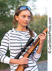 Girl with a sniper rifle - Young beautiful girl in a...