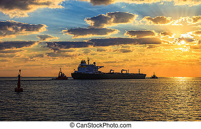 Solar Convoy - Tanker at sunset putting out to sea