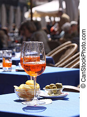Aperol glasses at an outdoor cafe on Piazza delle Erbe in...