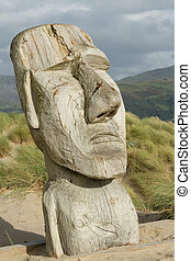 Wooden carving. - The face of a man carved into a section of...
