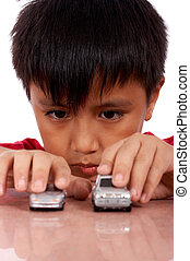 nine year old boy - nine year old boy playing toy car