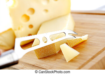 cheese with a cheese knife