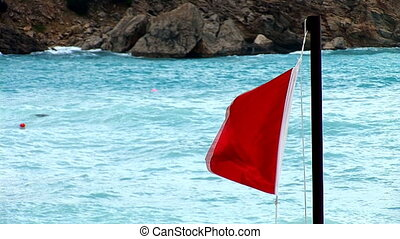 red flag 1 - triangular red flag on the background of the...