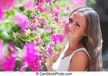 woman in flowers outdoor