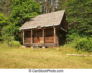 Small wooden barn in forest - old wooden barn in countryside