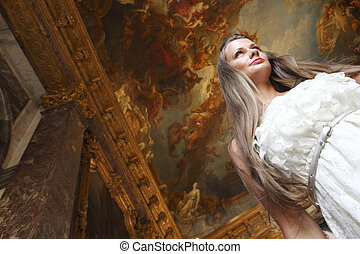Beautiful woman in a palace interior