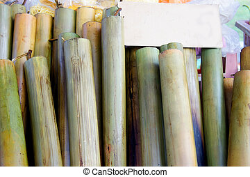 lemang cook - lemang is malaysian traditional food...