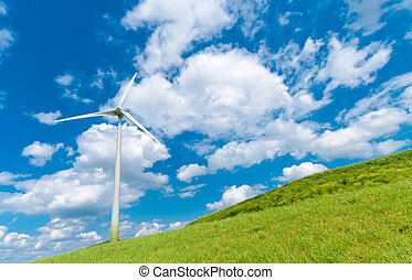 wind turbine on a hill under a cloudy blue sky