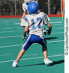 Football Action Play 4 - Teen youth Football in action on...
