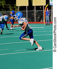 Football Action Play 3 - Teen Youth Football Player running...