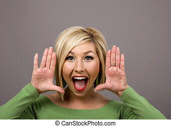 Blonde Yelling Through Hands - A blonde yelling toward...