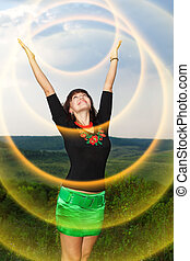 Girl controls yellow rays of the sun.