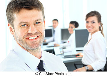 Portrait of mature business man smiling with hands folded during meeting