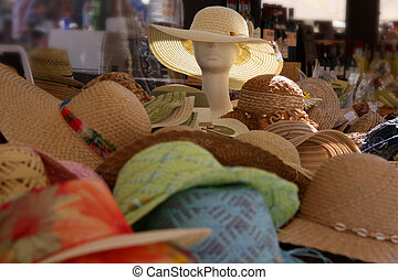 Colorful Straw hats at a market stall in Verona - Colorful...