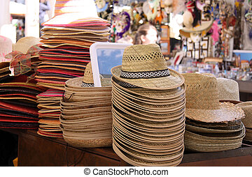 Straw hats at a market stall in Verona - Straw hats at a...