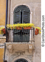 Balcony with flower decoration in the old town in Verona,...