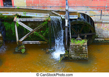 Mill wheel on stream Leuk too Leukbach in Saarburg,...