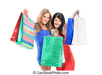 group of two happy young adult women out of shopping with colored bags